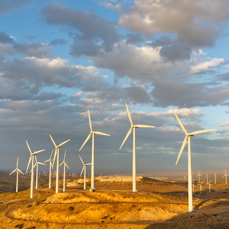 Windmills at Tehachapi Pass Wind Farm, California, generating clean renewable electrical energy without carbon dioxide emissions to fight climate change and global warming.