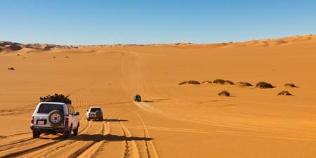 Desert Safari - Off-road vehicles driving in the Sahara Desert, Libya