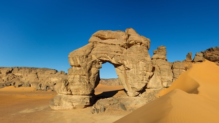 Panormaic view of natural arch in the Akakus Mountains Sahara Desert Libya