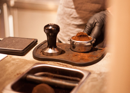 Tamping Espresso Shot with Hand by Barista