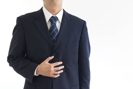 Photo for A man in a suit suffering from holding his stomach - Royalty Free Image