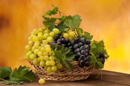 white and black grape in a basket