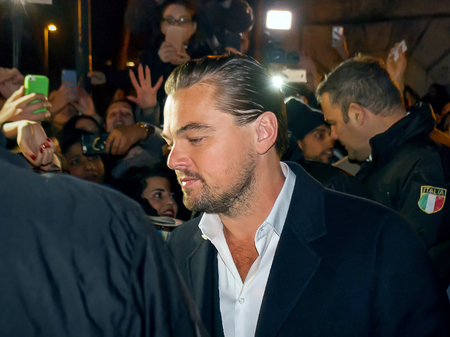 Rome, Italy - 15 January 2016: In the image Leonardo DiCaprio in the vicinity of the house of cinema in Rome. The actor is shown here surrounded by fans and security men. We are in a public place, in the street, before it enters the red carpenter.