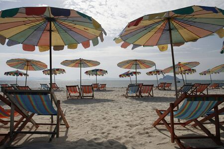 colorfully sun beds and umbrellas in an island