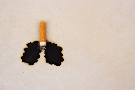 Photo pour The symbol of the smoked lungs. Burnt paper and cigarette butt. World No Tobacco Day concept. Stop smoking. - image libre de droit