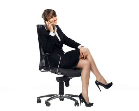 Photo for business woman sitting in office chair and talking on a phone, isolated on white background - Royalty Free Image