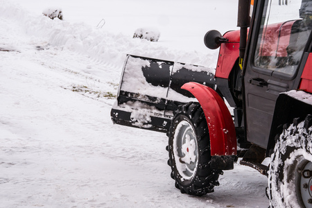 Foto de snow removal in the winter the tractor - Imagen libre de derechos