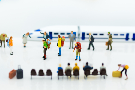 Miniature people: Many Travellers traveing by train at train station. Image use for Travel business concept.