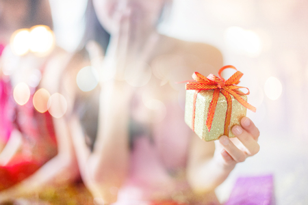Photo for She was surprised and happy and holding a gift box - Royalty Free Image