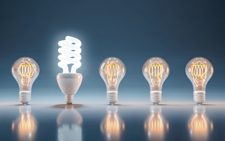 Foto de Incandescent and fluorescent energy saving light bulbs, innovation and solution - Imagen libre de derechos