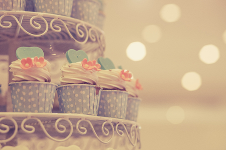 Cup cake for wedding ceremony. Cross processed image for vintage lookの写真素材