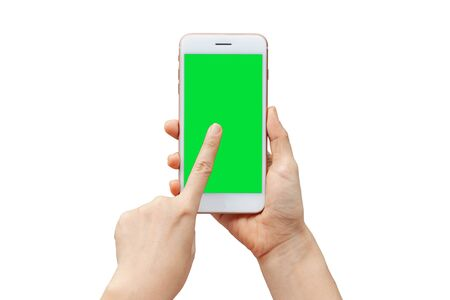 Photo pour Thai woman hand shows mobile smartphone with green screen in vertical position isolated on white background. - image libre de droit