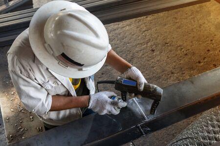 Foto de Checking defect in welded with process Magnetic Particle Testing(MT) of Non-Destructive Testing(NDT) at industrial factory. - Imagen libre de derechos
