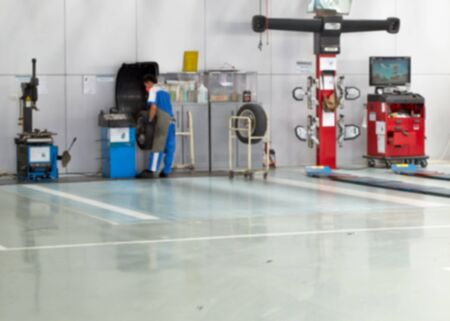 auto repair service station blurred background, Adjusting Wheel