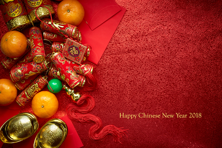 Photo pour Chinese coins or Chinese knot of luck and chinese firecrackers  and Chinese gold ingots and Traditional chinese knot  (Foreign text means blessing) and Red envelopes and decoration with Fresh oranges on Red Paper background  - image libre de droit