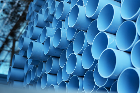 Foto de background of colorful  Blue PVC pipes stacked in construction site - Imagen libre de derechos
