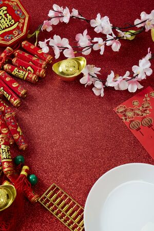 Photo pour Top view Decorate Chinese New Year Ornament or lunar new year on red background, Firecracker and Lucky Knot and Plum Blossom (with the character fu meaning fortune) - image libre de droit