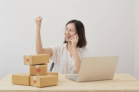 Photo for Happy young asian small business owner working at home office, Online marketing packaging delivery, startup SME entrepreneur or freelance woman concept - Royalty Free Image