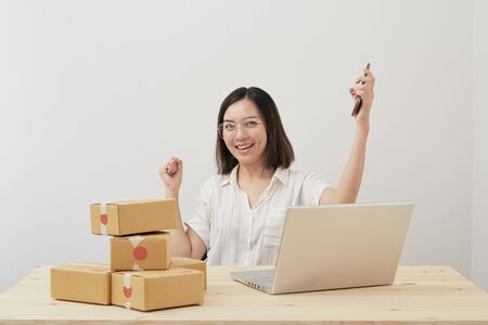 Photo pour Happy young asian small business owner working at home office, Online marketing packaging delivery, startup SME entrepreneur or freelance woman concept - image libre de droit