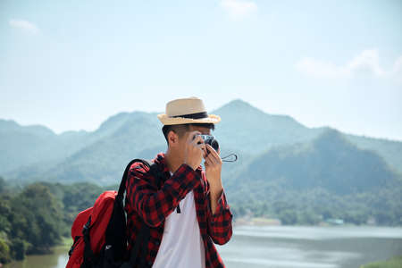 Photo for Young hipster Asian man traveling with a backpack in summer forest trip travel lifestyle concept - Royalty Free Image