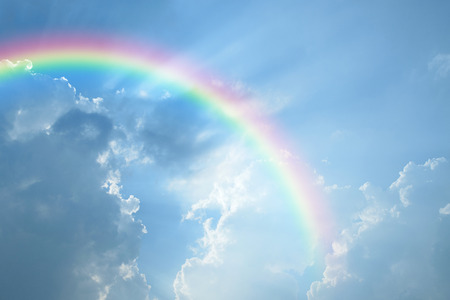 Photo for Blue sky and white cloud with sun light and rainbow - Royalty Free Image