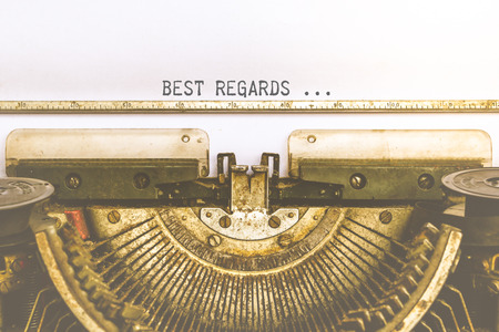 Vintage typewriter and a empty white paper with a word Best Regards, process in vintage style
