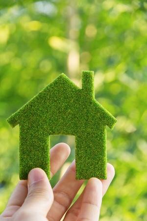 Photo pour hand holding eco house icon concept  - image libre de droit