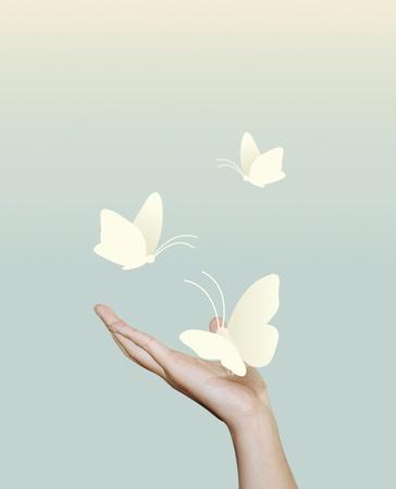 Foto de  butterfly paper on hand paper cut style - Imagen libre de derechos