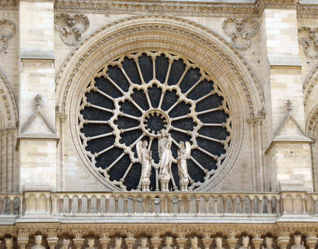 Beautiful church window on the Notre Dame cathedral in Paris.