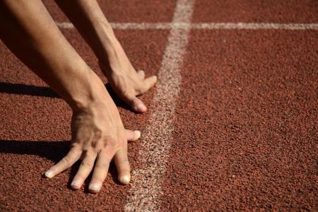 Run Mans Hand in position of Start Running at Running Track. Hand Running Track White Lines.
