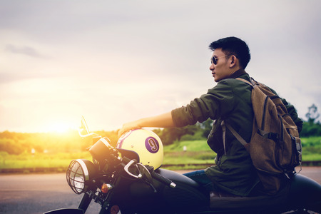 Photo for Biker man and motorcycle with river background, Rider moto trip on the street at the riverside, enjoying freedom and active lifestyle. - Royalty Free Image