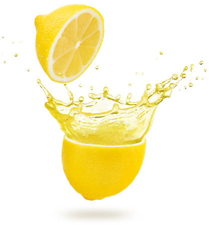 Photo for yellow juice exploding out of a lemon isolated on white background - Royalty Free Image