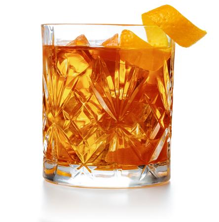 Foto de old fashioned cocktail garnished with orange twist peel isolated - Imagen libre de derechos