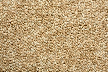 A beige carpet texture, close-up