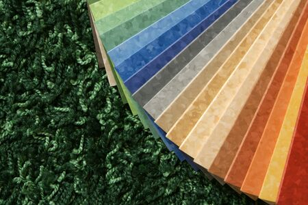The samples of collection multicolored linoleum on green carpet background