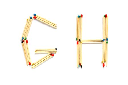 Letters G and H made of matches on a white background