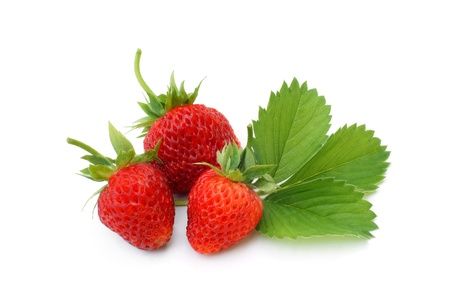 Fresh strawberries with leaves on a white background