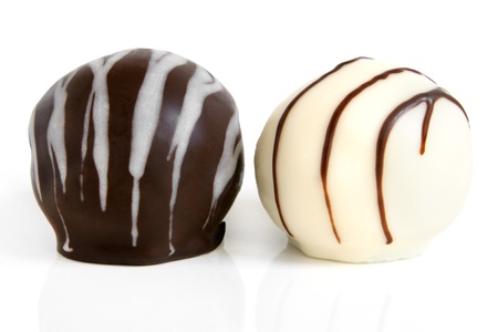 Photo pour Chocolate sweets on a white background - image libre de droit