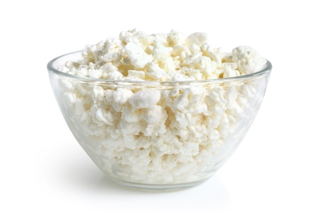 Cottage cheese in glass bowl on a white background