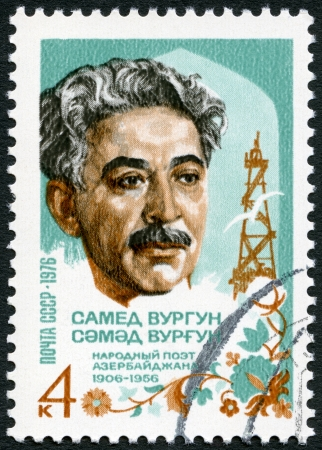 USSR - CIRCA 1976: A stamp printed in USSR shows Samad Vurgun (1906-1956), national poet of Azerbaijan, and derrick, circa 1976
