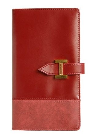 Red leather notebook isolated on a white background