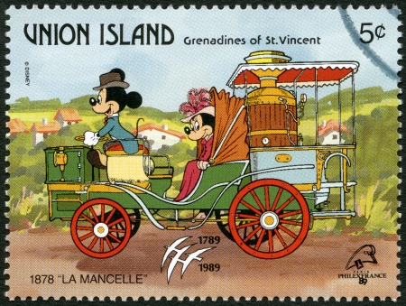 ST. VINCENT GRENADINES - UNION ISLAND - CIRCA 1989: A stamp printed in St. Vincent Grenadines shows Mickey Mouse and Minnie Mouse, 1878 La Mancelle, series Disney characters in various French vehicles, circa 1989