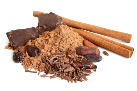 Cacao beans, cacao powder, cinnamon bark and chocolate on a white background