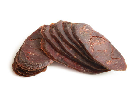 Slices of dried cured beef on white