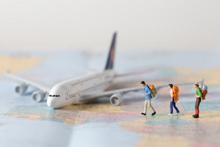 Foto de Miniature model team traveller model standing together on map, people travel in concept, - Imagen libre de derechos