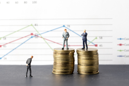 Miniature model group of businessman  standing on coin, business successful concept.