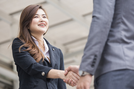 Photo for Asian businesspeople shaking hands greeting each other. - Royalty Free Image