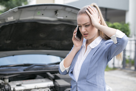 Young Woman in Stressed situation with Car Defect Engine breakdown