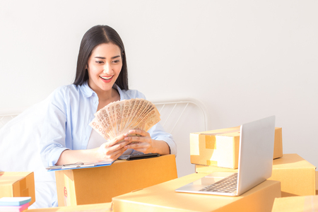 Photo pour Young Asian Woman Working at home, Young Owner Woman Start up for Business Online. People with online shopping SME entrepreneur or freelance working concept. - image libre de droit