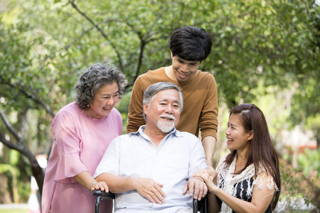 Photo for Portrait Of Asian Family Relaxing In Park Together. People lifestyle concept. - Royalty Free Image